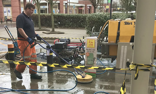 Rotary pressure cleaning equiment for cleaning paved areas
